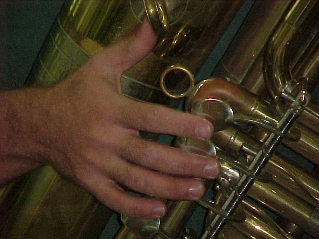 Arnie's hand playing his tuba